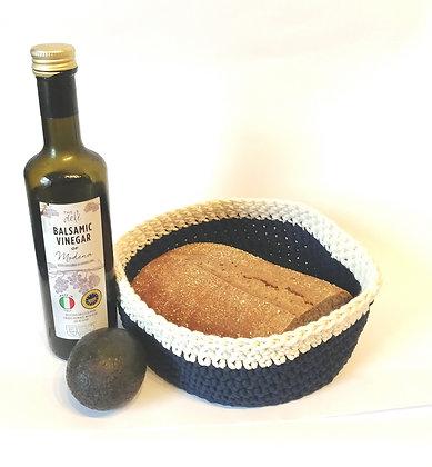 Beautiful hand crocheted bread basket. Using macrame yarn.