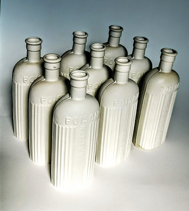 Handmade cast decorative poison bottles