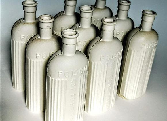 Handmade cast decorative poison bottles