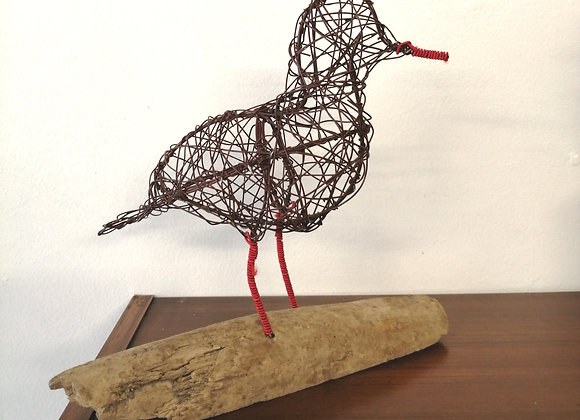 Lapwing wire bird sculpture mounted on driftwood