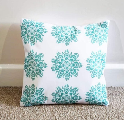 Green mandala cushion by Sarah Bell