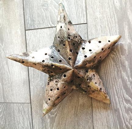 Ceramic star with room for lights inside