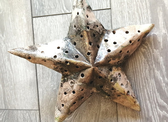 Ceramic star with room for lights inside