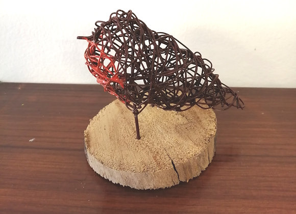 Robin wire sculpture mounted on driftwood