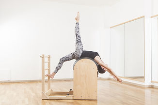 Beautiful woman performing pilates exerc