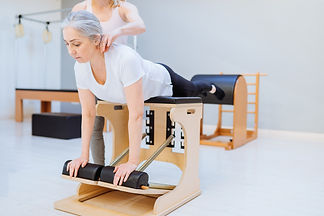 Elderly woman woman doing pilates on the