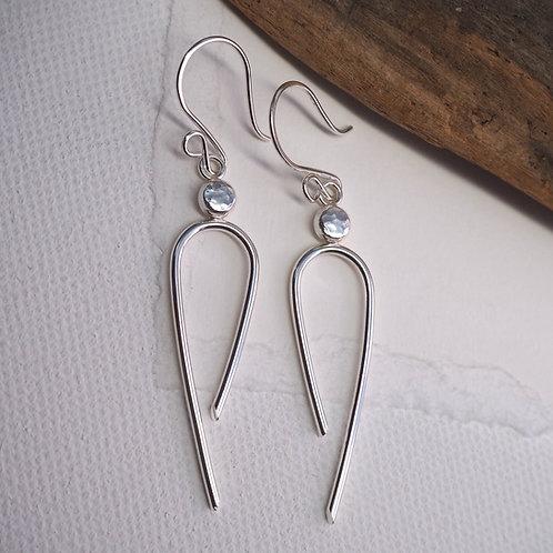 Long silver arc earrings