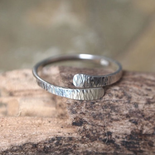 Forged silver rings with shimmer texture