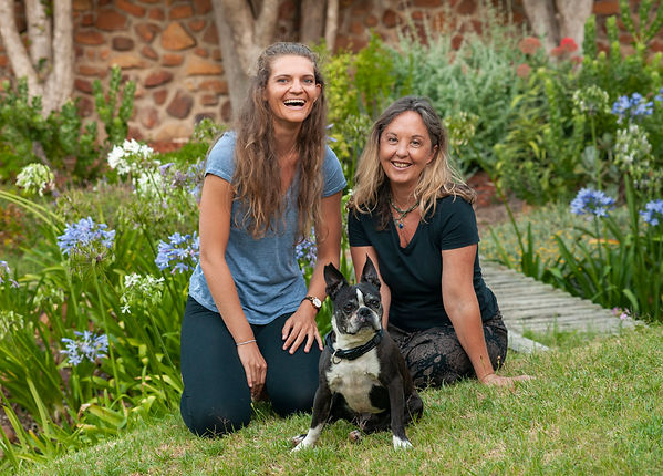 Owners of Sattva Yoga Gear with Churchill the company mascot