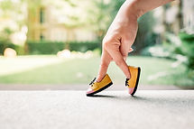 woman hand finger walking with shoe conc
