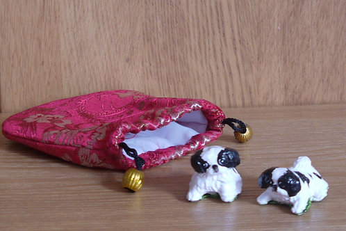Two Puppy Figurines with small pouch
