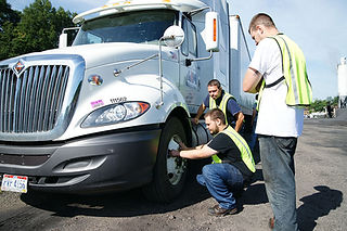 CDL Drivers Fixing Tire