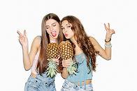 Summer portrait of two pretty brunette g