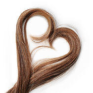 Strands of brown hair in shape of heart,