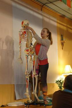 Jessica teaching anatomy at Yoga Teacher Training Dharma Yoga