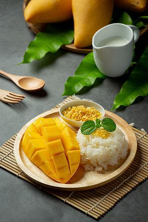 fresh-ripe-mango-sticky-rice-with-coconut-milk-dark-surface (1).jpg