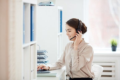 young-businesswoman-wearing-headset-at-w