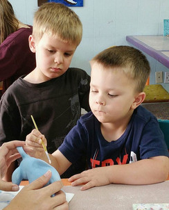 There is some deep concentration happening in our shop today. Caleb is painting the perfect elephant as his brother, Garrett, watches.jpg