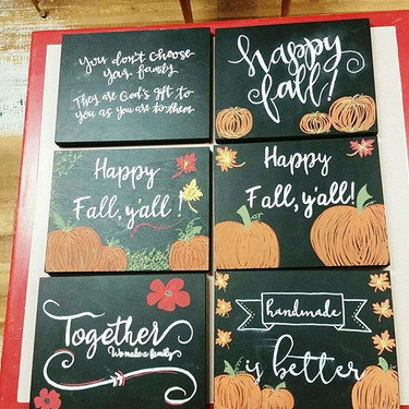 We had a fabulous chalk board writing class last night! Check out some of the finished boards.jpg