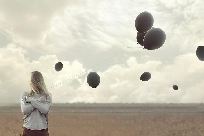 girl with black balloons lisc.jpeg