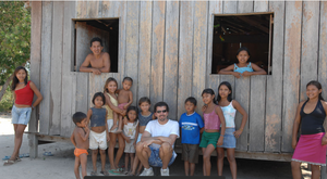 Kurywchak taking a break with village residents while setting up telemedicine at a clinic on an island in the Amazon (Telemedicine.com)