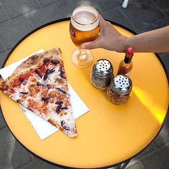 Pizza with Black olives and a Cup of beer