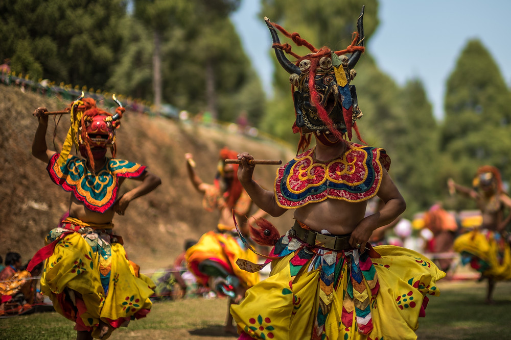 Performance of mask dances during Talo Tshechu in Paro