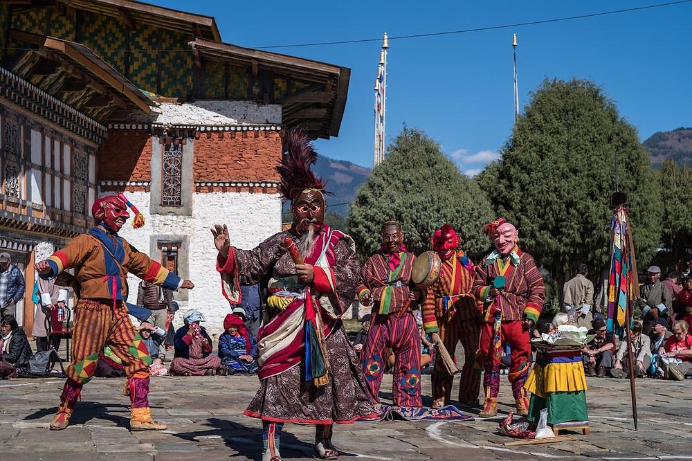 Atsara, or clowns, entertaining the crowd during Jambay Lhakhang Drup