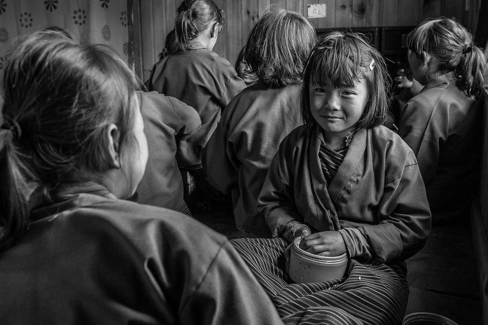 Bhutan schoolgirl having lunch