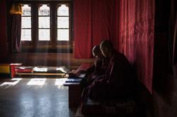 Monks during prayer in Bhutan