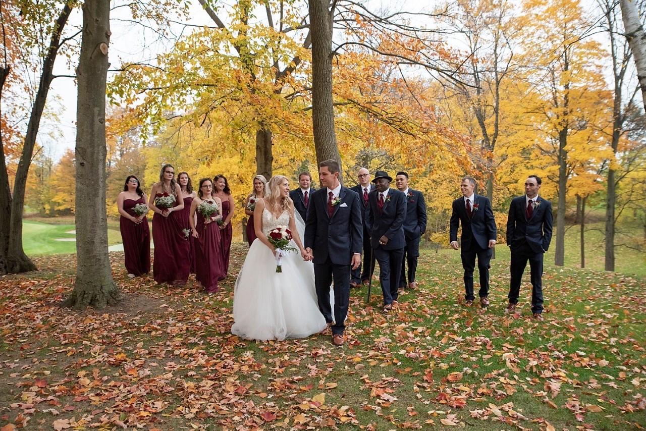 Bridal Party Walking in Woods.jpg