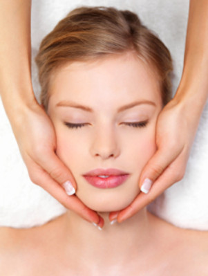 Young pretty woman receiving face massage