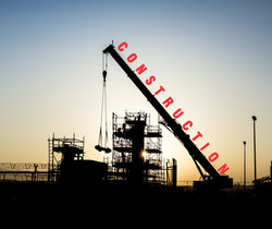 Silhouette of mobile crane working in ga