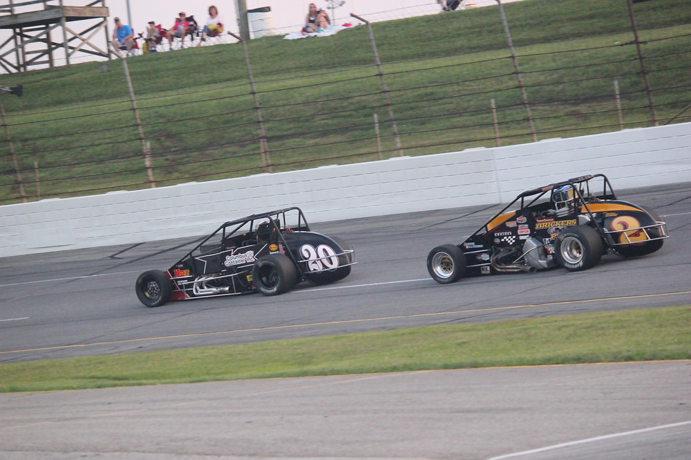 Jerry Coons Jr. (#20) leads another competitor into Turn 1 at Lucas Oil Raceway in Indianapolis. (Glenda Lacer photo)
