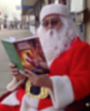 "Santa Claus reads ""Stories for the 12 Days of Christmas."""