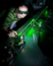 female scientist working with lasers whi