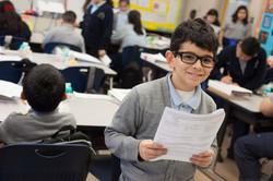 smiling-boy-w-paper_orig
