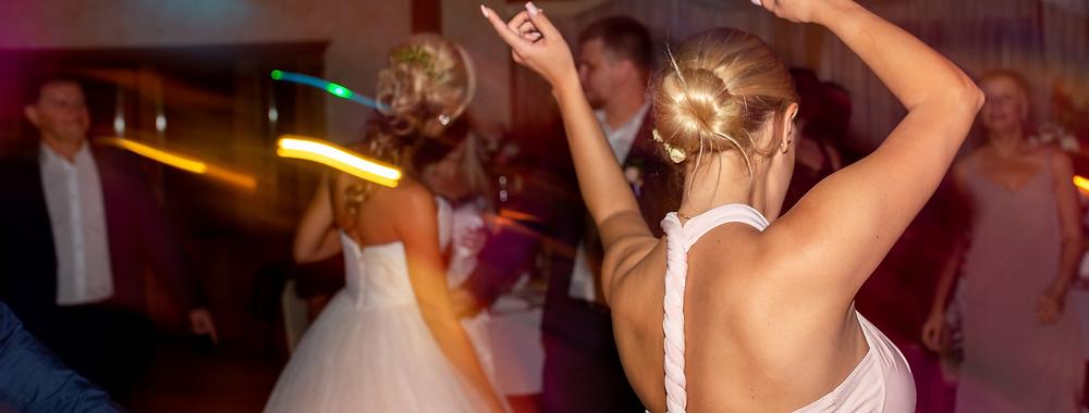 bride enjoying her wedding dj at her wedding reception