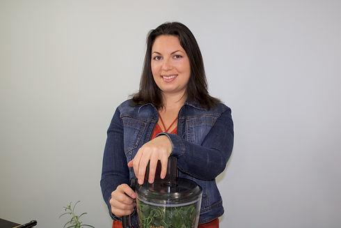 registered holistic nutritionist making food