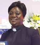 mercy with ordination cert.jpg