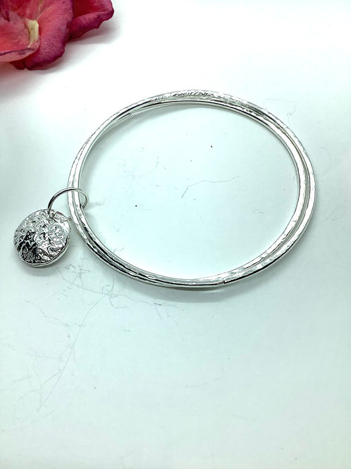 Double bangle bracelet with textured silver drop
