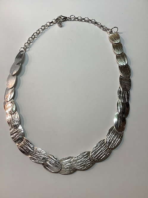 Sterling Silver Riveted Oval Necklace with length adjustable chain.