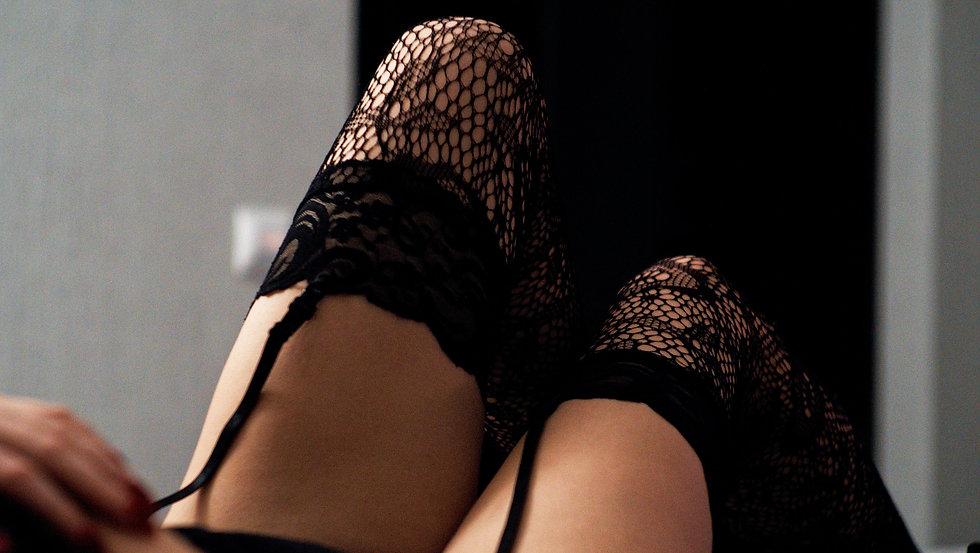 Fishnet stockings and black lingerie.