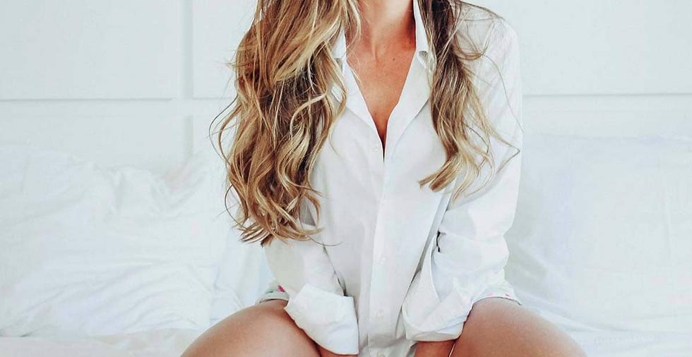 Woman in white shirt.