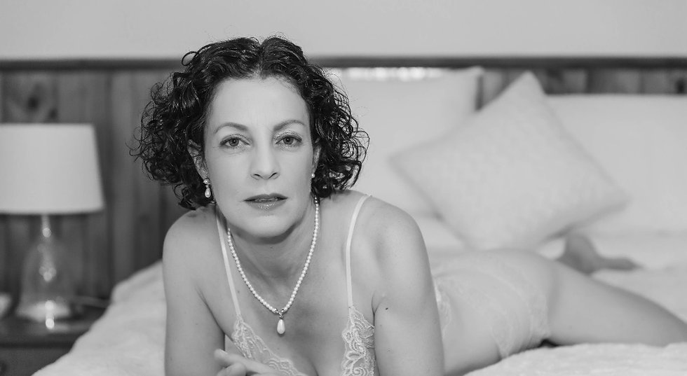 Sharon on the bed at her boudoir shoot_edited.jpg