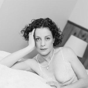 Ms T on bed in black & white..jpg