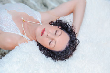 Ms S in whote on white rug at her boudoir shoot_edited.jpg