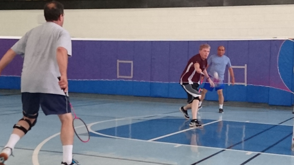 Karsten plays a low shuttle while Harry holds the back court