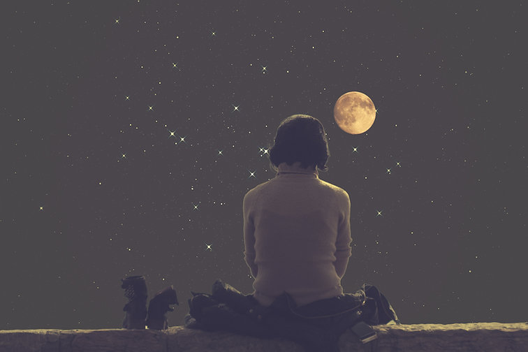 woman looking at the full moon