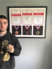Boxer Joel Bartell with his medals